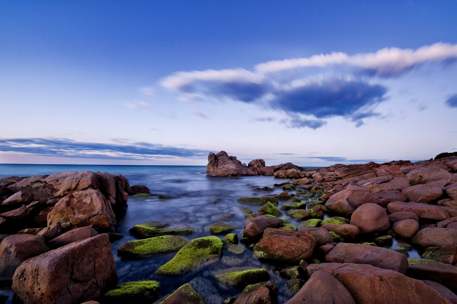 Rocky shore with red rocks at Meelup, Western Australia Copyright Brian Smyth